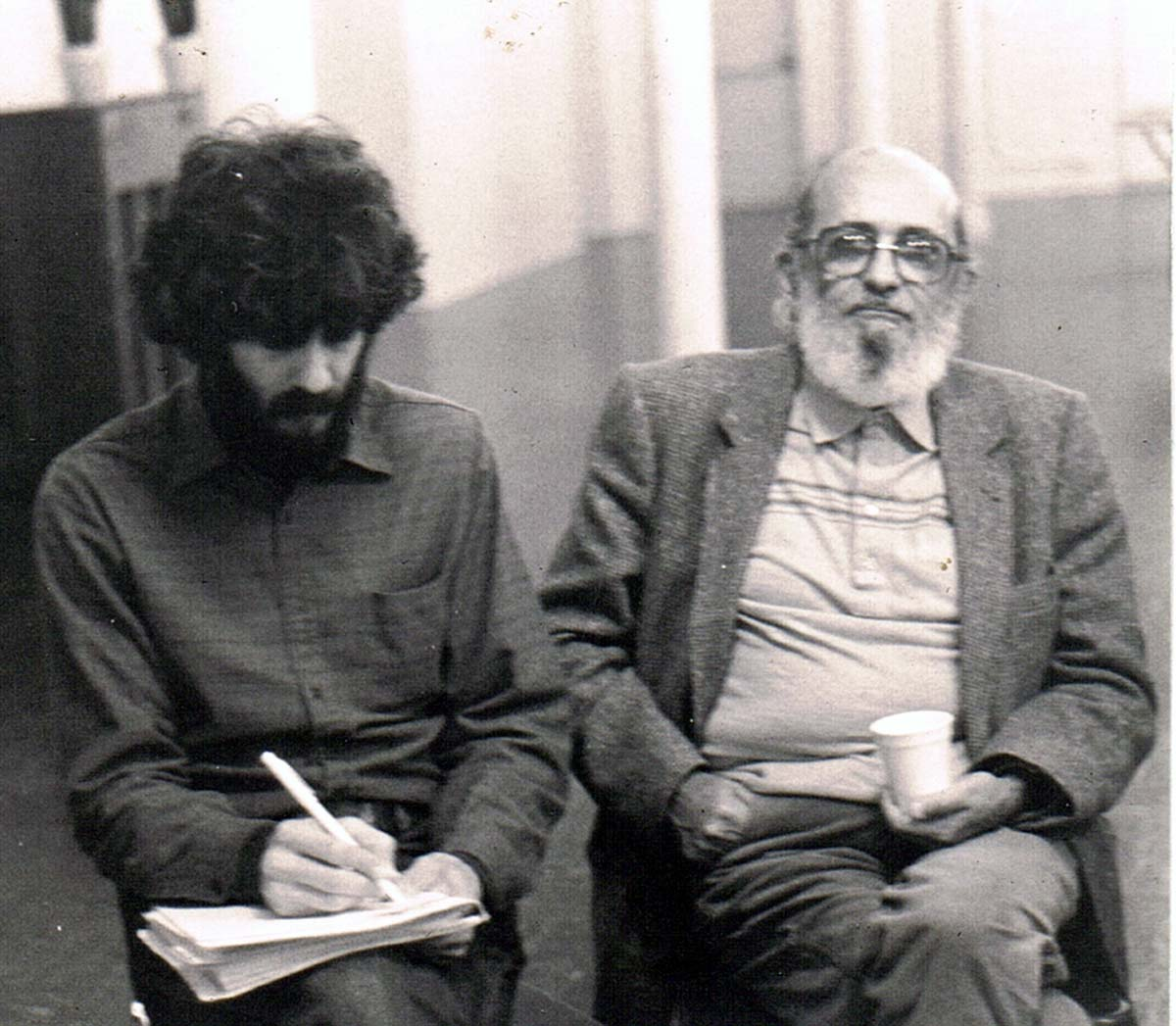 Paulo Freire With unidentified participant at he Tenderloin Reflection Center circa 1983-85 at Bible Study Group at St. Boniface